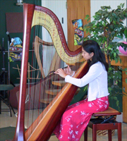 San Jose harp student Audrey performs in recital