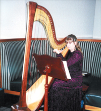 Providing harp music for Sunday brunch at the San Jose Hilton hotel